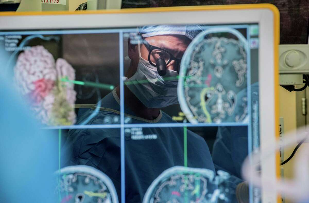 Neurosurgeon Edward Chang performs brain surgery at UCSF. Chang's work has created the foundation for the technology that translates the unspoken words of a completely paralyzed man into written speech.