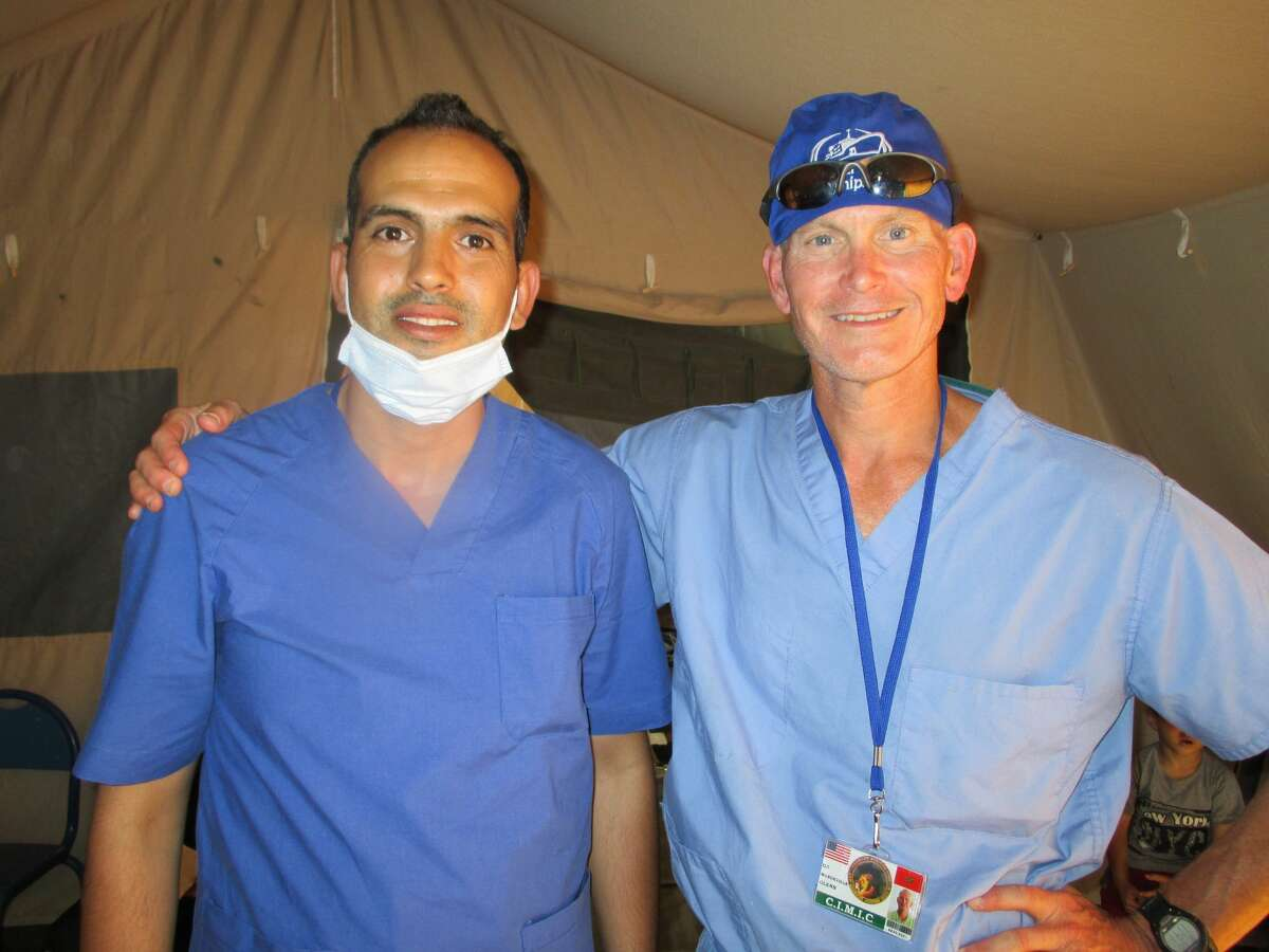 Dr. Glenn Mandeville (right) poses for a photo with a Moroccan surgical resident in Morocco while on the Africa Lion 2021 exercise.