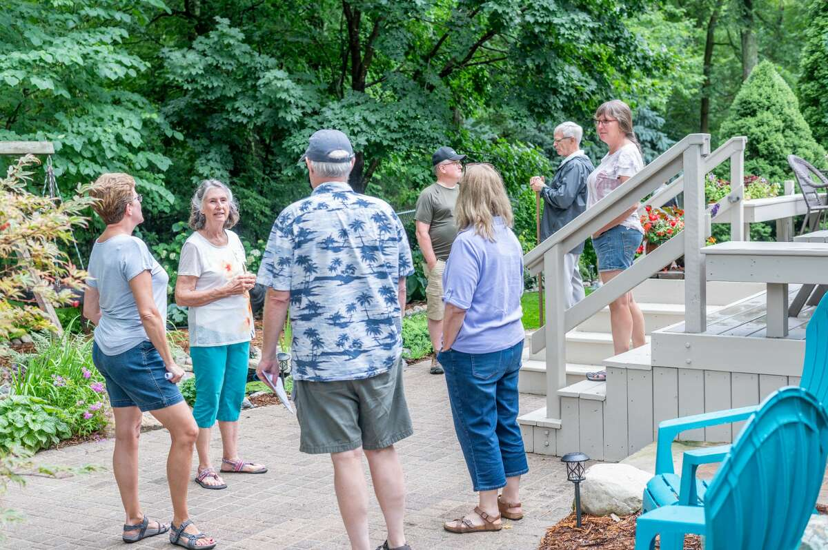 Vistors enjoy the Steffen garden during the 18th Annual Reece Endeavor of Midland Garden Walk on Tuesday, July 13, 2021. (Adam Ferman/for the Daily News)