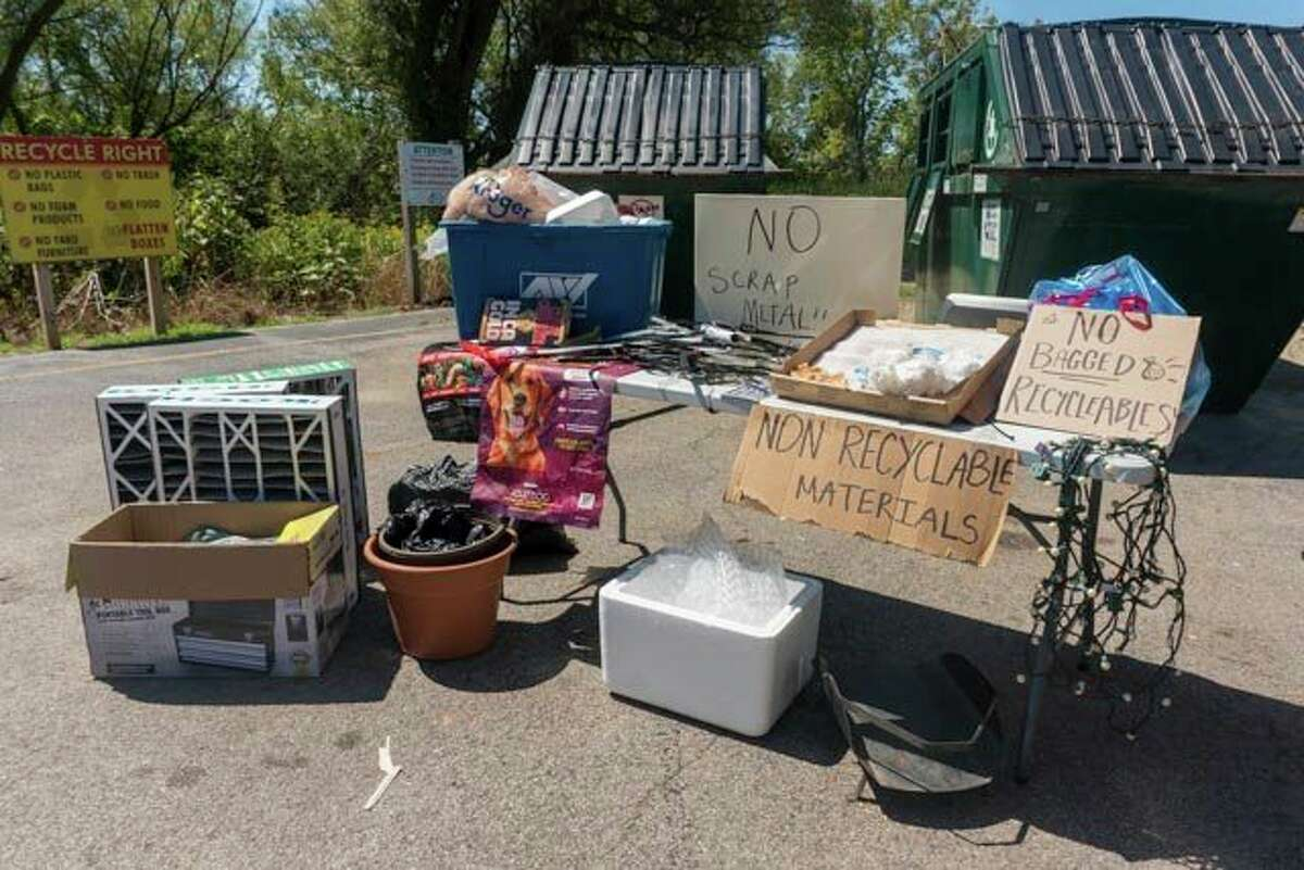 Manistee County's recycling program recently took items from recycling drop off bins that did not belong and shared them on display tables in an effort to educate anyone planning to recycle at the eight townships involved in the program. (Courtesy photos)
