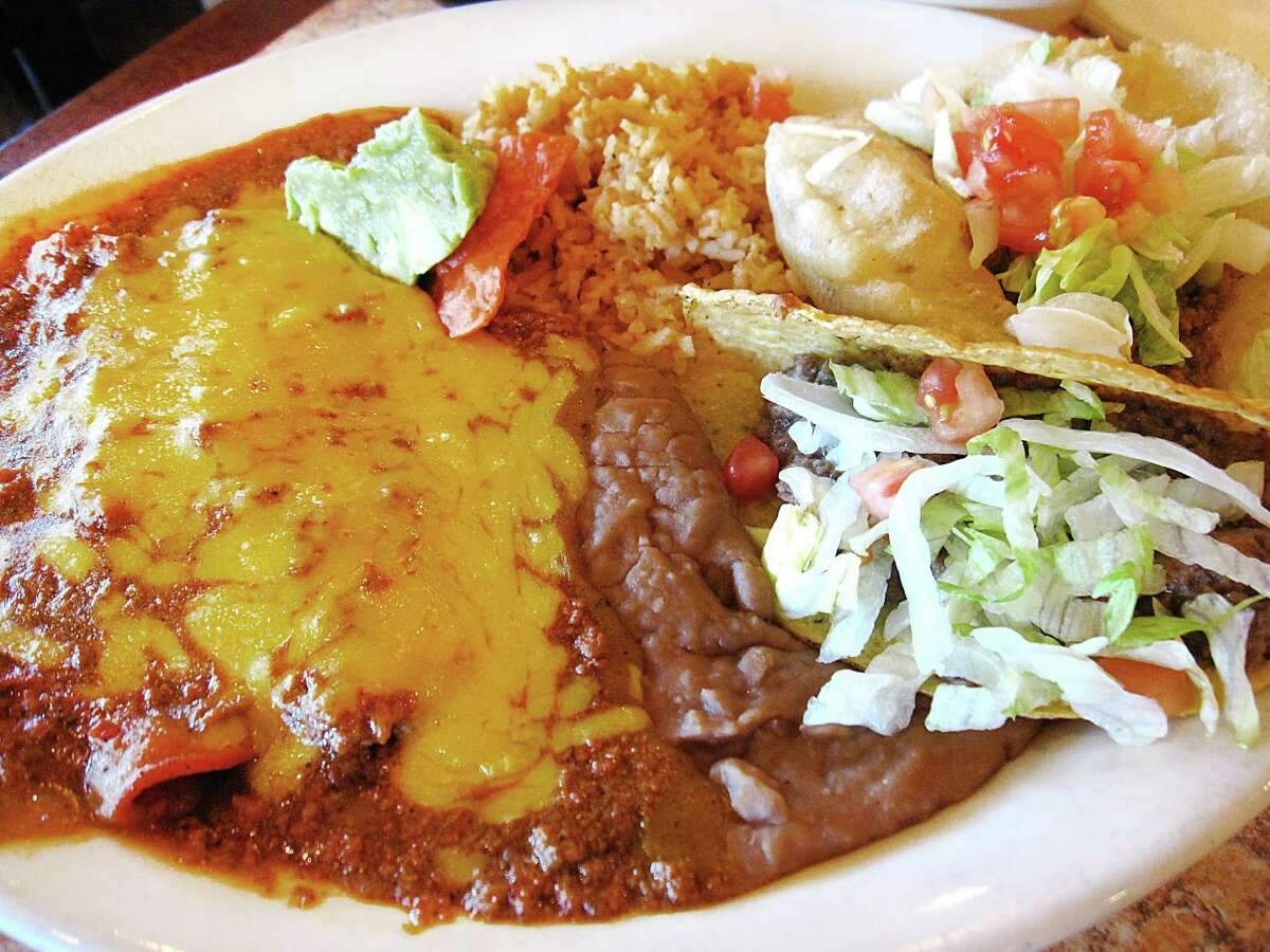The Special Platter includes cheese enchiladas, rice, beans, a puffy taco and a crispy taco from Los Barrios Mexican Restaurant on Blanco Road in San Antonio.