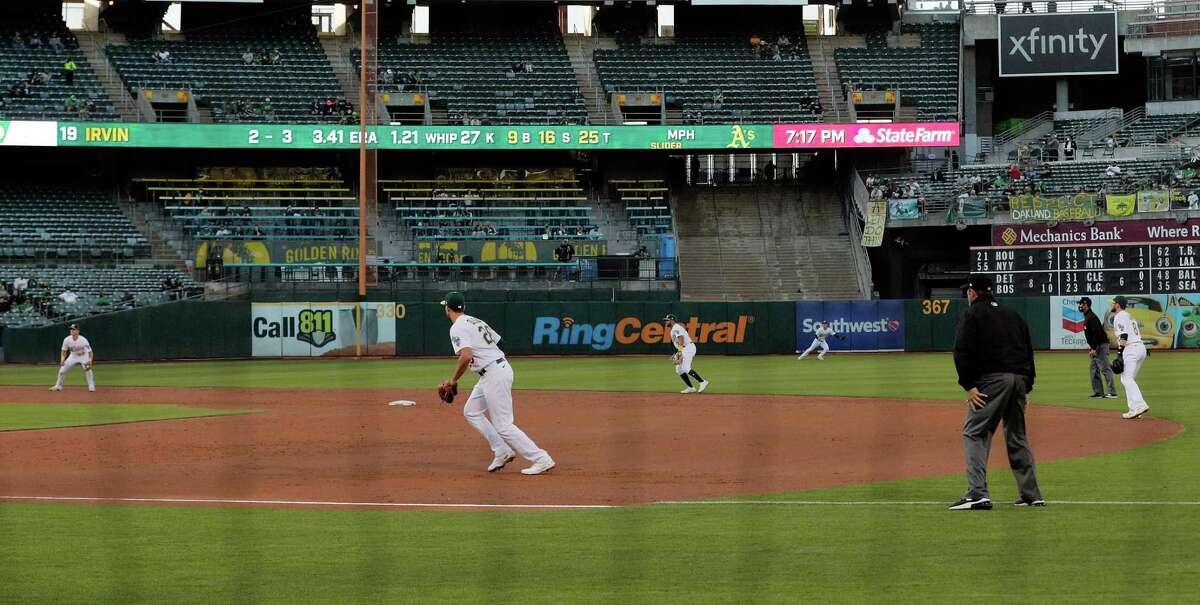 Facing the Blue Jays in May, the Oakland A's employ a defensive shift with third baseman Matt Chapman near short, shortstop Vimael Machin positioned near second base, and second baseman Jed Lowrie near shallow right field. Matt Olson is at first.