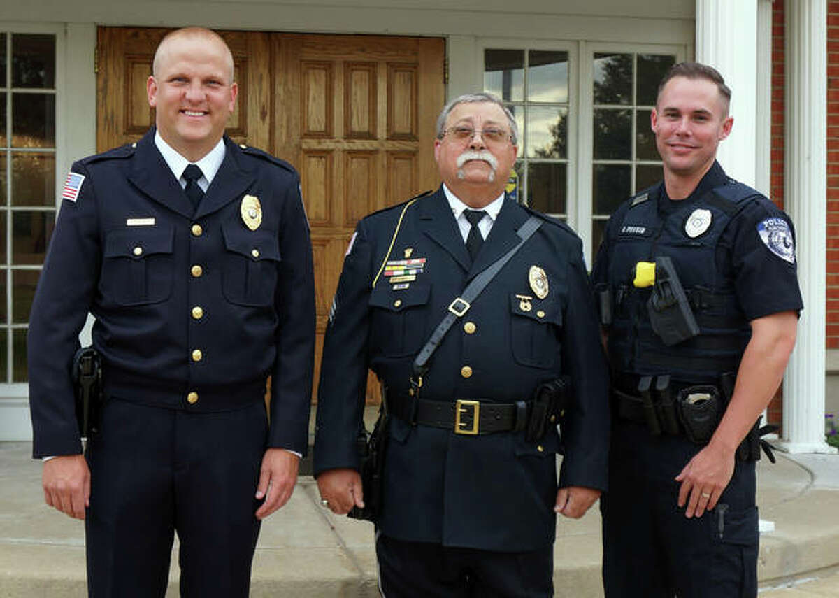 """Past, present and future represented in Glen Carbon Police Department officers: retired sergeant James """"Sarge"""" Jones, center, flanked by new Sgt. Steven Deist, left, and the village's newest police officer, Aaron Porter. All three were recognized at the Board of Trustees meeting Tuesday at village hall."""