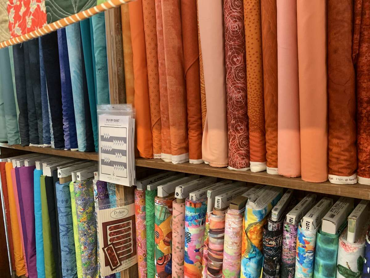 Las Colchas gets its 100% cotton fabrics from across different suppliers across the nation, and they come in a wide variety of patterns and colors. Plenty of fabric lines the walls on July 14, 2021.