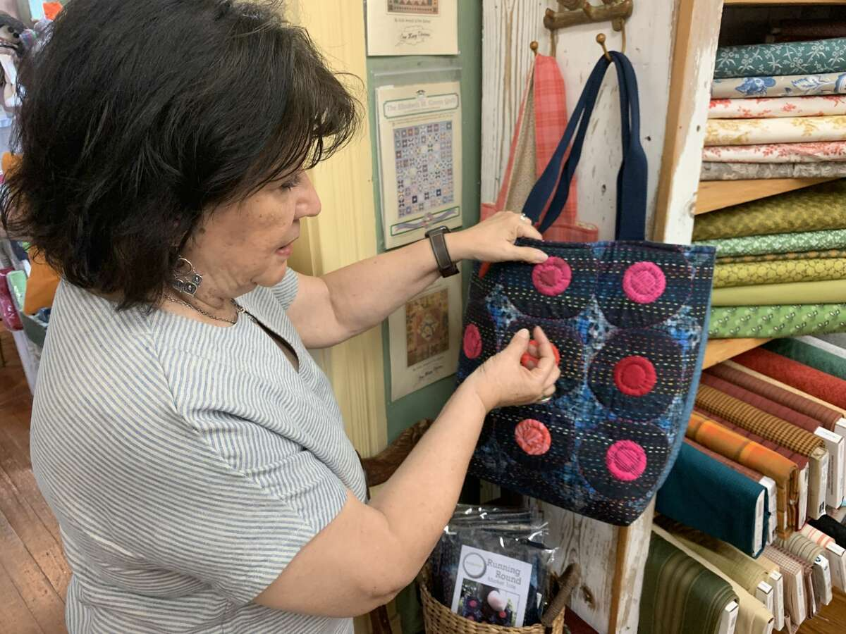 Francine shows disconnected  1  of her bags she made utilizing Japanese Sashiko stitching connected  July 14, 2021.