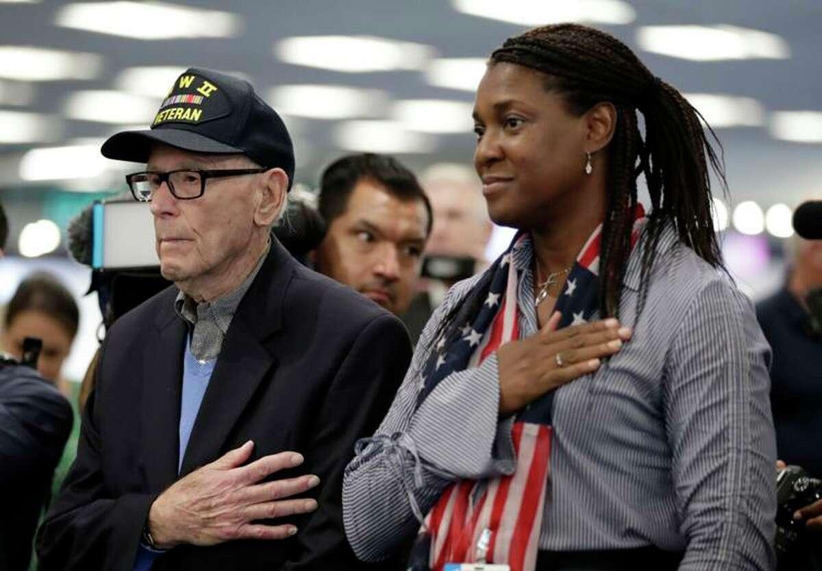 World War II veteran Sydney Levit, 94, stands with Paula Jarrett during an Honor Flight sendoff celebration.