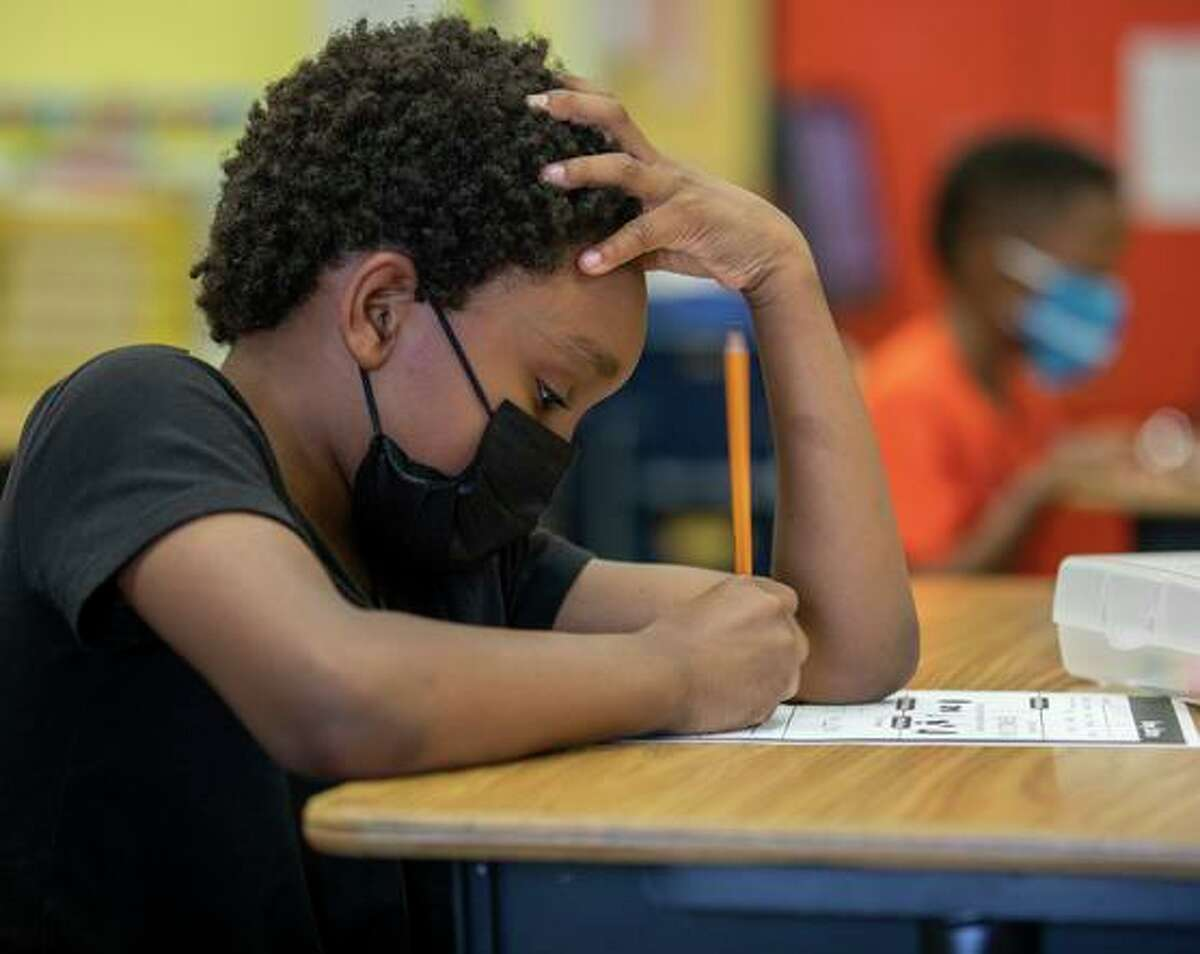 A first grade student doing classwork at Oakland's Cleveland Elementary in May.
