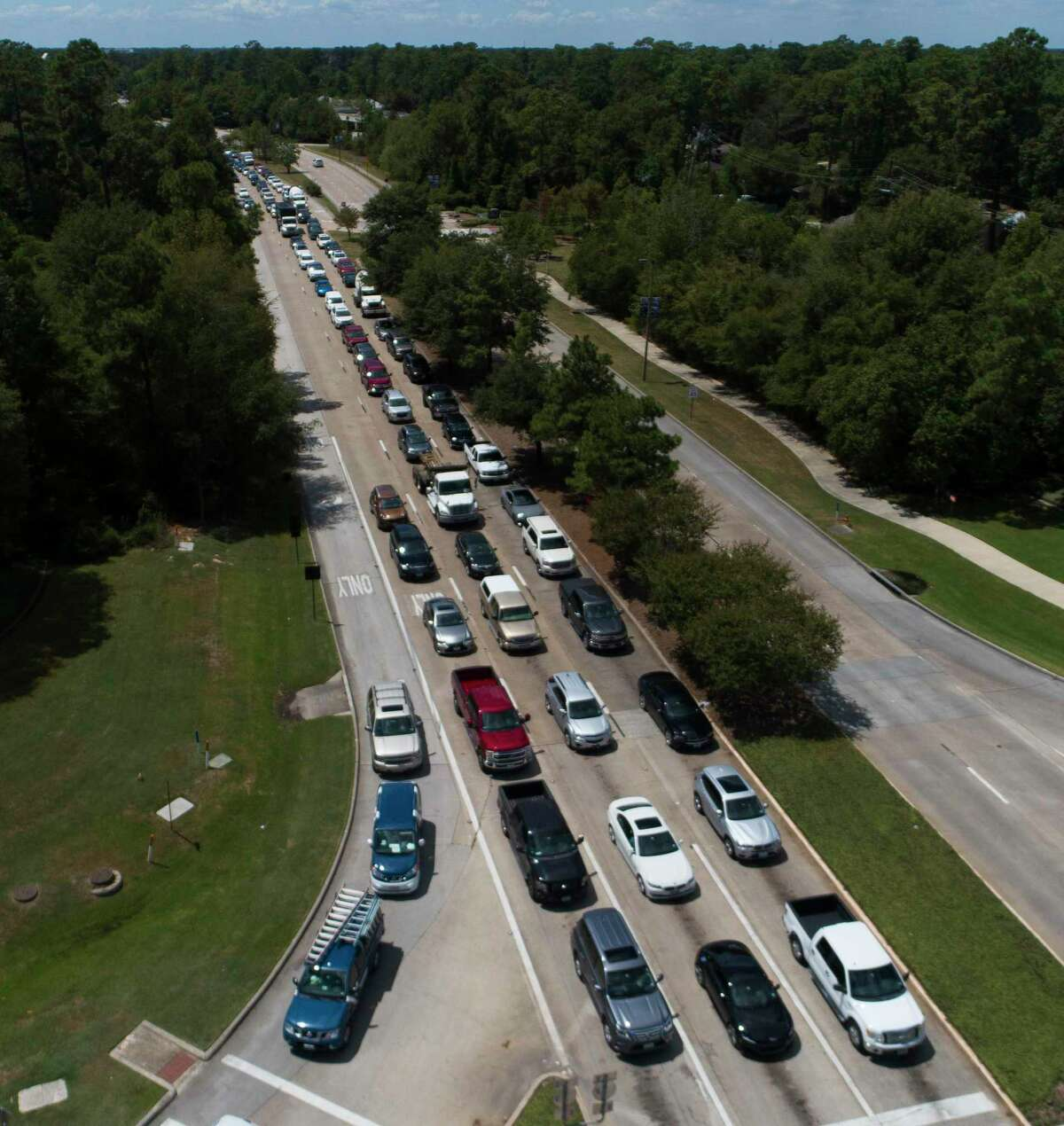Vehicles are back up on Research Forest Drive near I-45 after power to many of the area's traffic lights went out in addition to homes and businesses, Thursday, Aug. 27, 2020. More than 100,000 customers lost power as of Thursday afternoon as Entergy-Texas began rolling power outages for its Texas customers after extensive damage to the company's transmission system caused by Hurricane Laura.