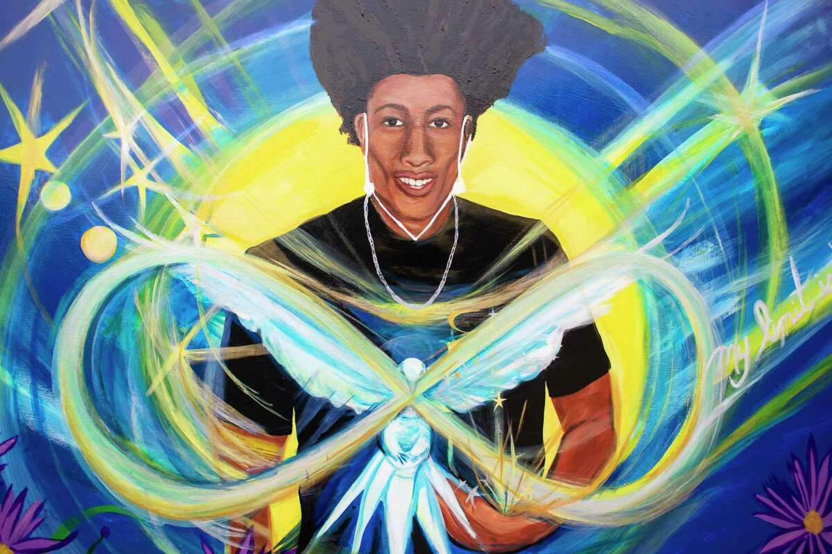 A mural of Demetrius Fleming-Davis, who was killed by a stray bullet in April while riding home in a friend's car in Oakland, hangs in the Berkeley Alternative Resource Center garden, where he used to spend his days.