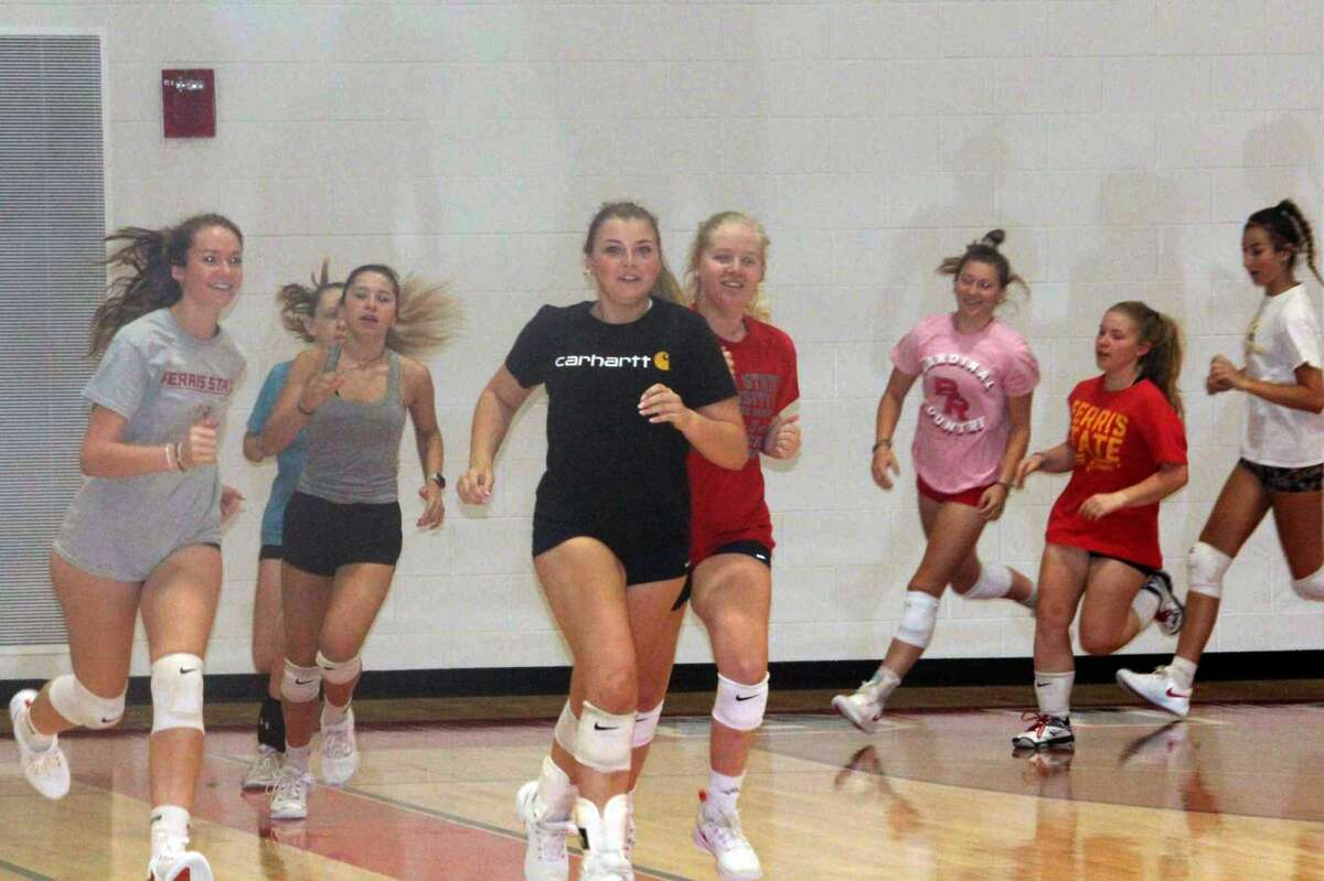 Big Rapids volleyball players conduct a conditioning workout during a volleyball summer practice on Tuesday.