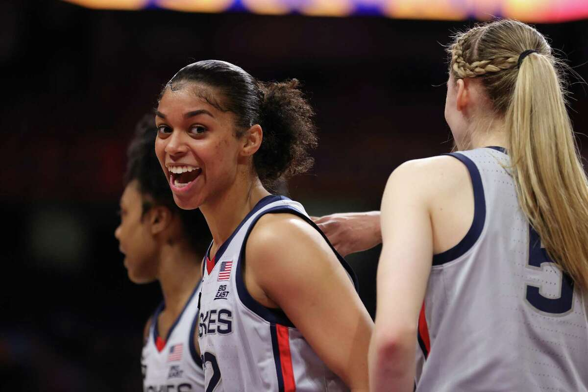 Evina Westbrook (22) of the UConn Huskies reacts to a call against the Arizona Wildcats during the first quarter in the Final Four semifinal game of the 2021 NCAA Women's Tournament at the Alamodome in San Antonio, Texas.