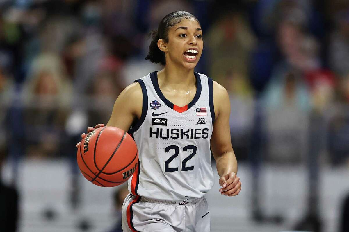 Evina Westbrook of the UConn Huskies dribbles downcourt against the Arizona Wildcats during the second quarter in the Final Four semifinal game of the 2021 NCAA Women's Tournament at the Alamodome in San Antonio, Texas.