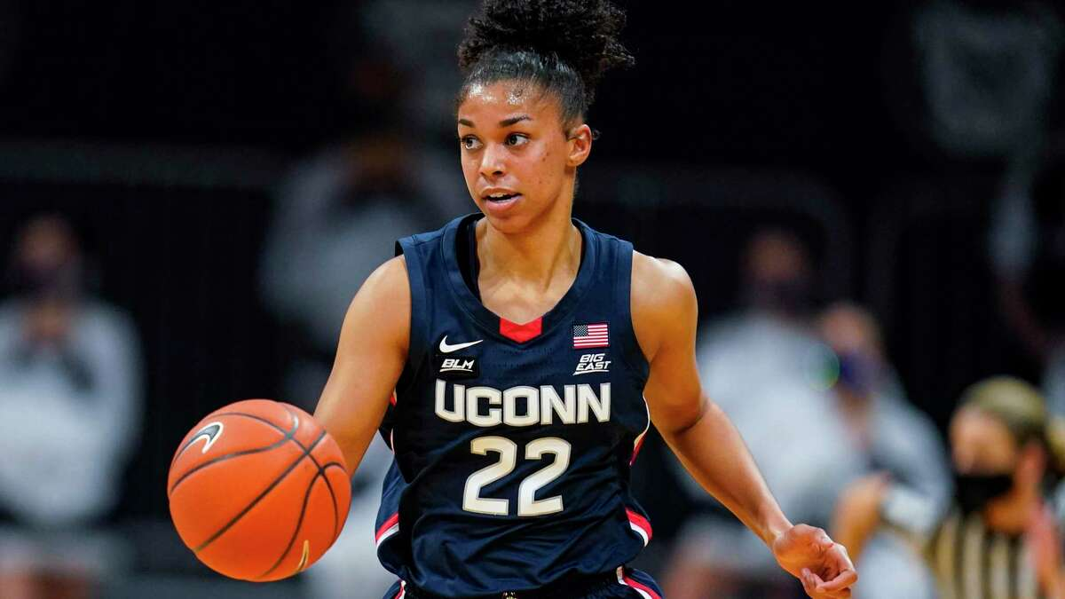 Connecticut guard Evina Westbrook (22) plays against Butler during the first quarter of an NCAA college basketball game in Indianapolis, Saturday, Feb. 27, 2021. (AP Photo/Michael Conroy)
