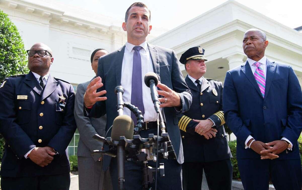 San Jose Mayor Sam Liccardo, alongside law enforcement officials, discusses a meeting with President Biden on gun violence Monday.