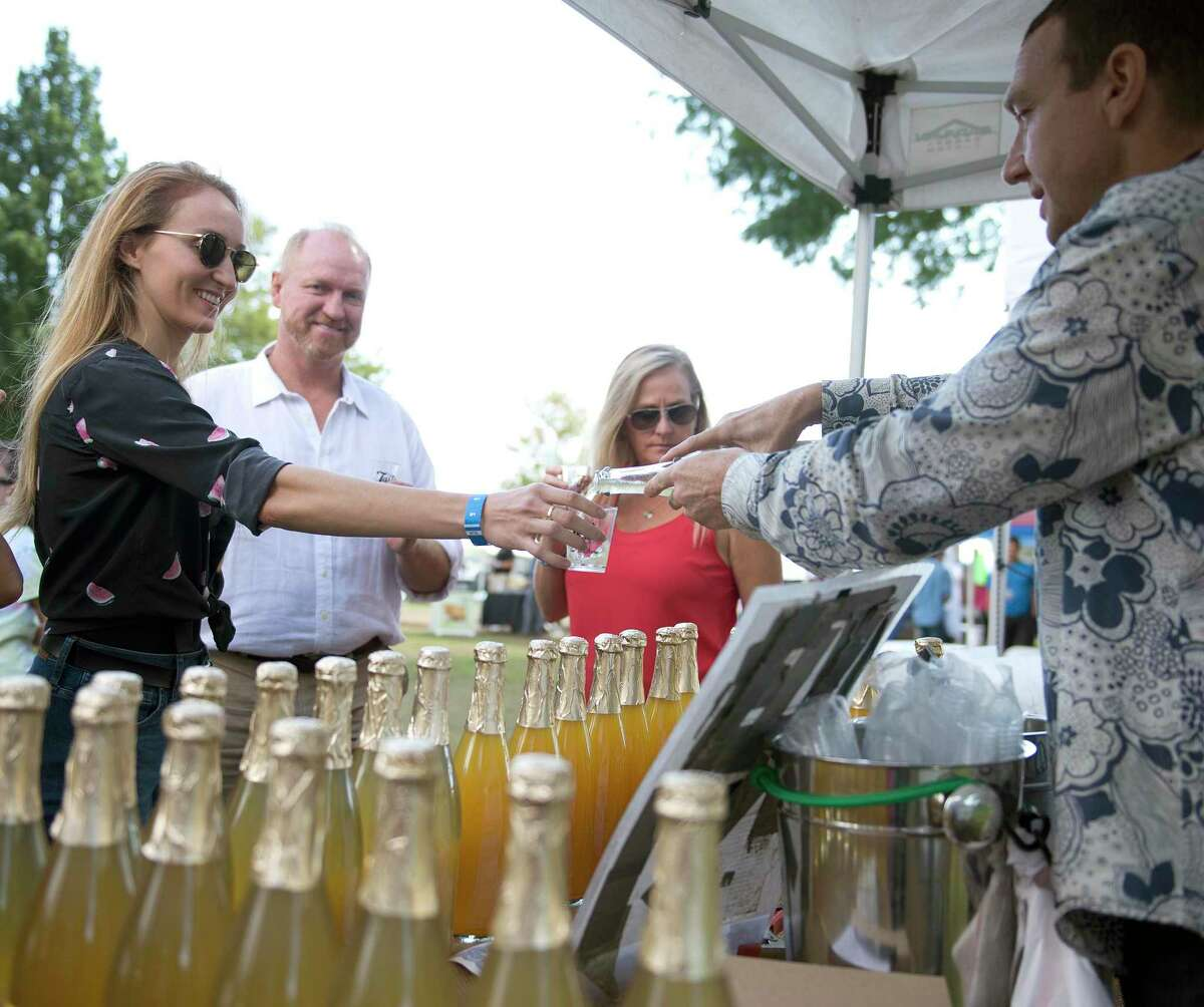 Kristi Kelly of Greenwich gets a sample of Champagne Tea Kombucha during the Last Taste of Summer Craft Beer Festival at Roger Sherman Baldwin Park in Greenwich, Conn., on Saturday, September 29, 2018.