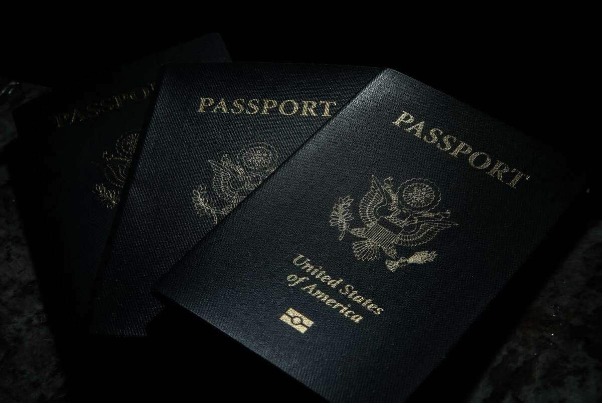 Passports belonging to the John family, photographed Wednesday, July 14, 2021, at their home in Cypress. The family had to cancel two trips to Mexico, one to visit family and the other for a wedding, because their Malakai's passport was delayed.