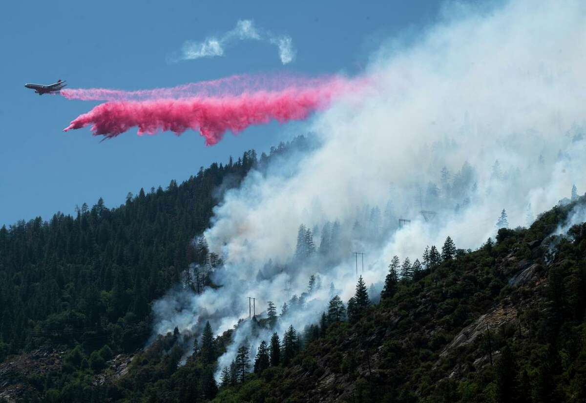 An air tanker drops fire retardant on the Dixie Fire in the Feather River Canyon in Plumas County on Wednesday.