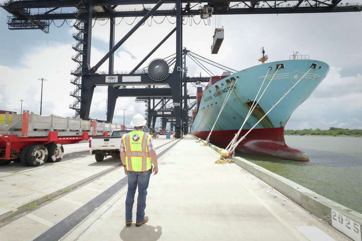 Vessel Services Superintendent, Cody Young watches the Marsk Kensington ship be unloaded Wednesday, July 14, 2021, in Houston. Work to expand the port's imports/exports have increased and bolstered trade in Houston since the expansion of the Panama Canal in 2016.