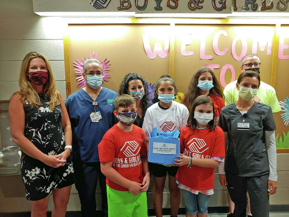 The Torch Club members of the Boys & Girls Club of the Lower Naugatuck Valley recently presented gift cards to Griffin Hospital nurses in appreciation for their dedicated service during the coronavirus pandemic. Pictured front row from left are: Torch Club Members Jonathan, Ashley and Melanie; and Jenna Papandrea, Griffin Hospital student nurse intern. Back row from left are: Shayne Roscoe, executive director of the Boys and Girls Club of the Lower Naugatuck Valley in Connecticut; Ed Valente, manager of Griffin Hospital ICU, Ashley D'Agostino, Griffin Clinical nurse educator, Torch Club Member Erin; and Mike Cannici, Torch Club program director.