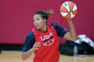 Napheesa Collier grabs a rebound during practice for the U.S women's basketball team in preparation for the Olympics, Tuesday, July 13, 2021, in Las Vegas. (AP Photo/John Locher)