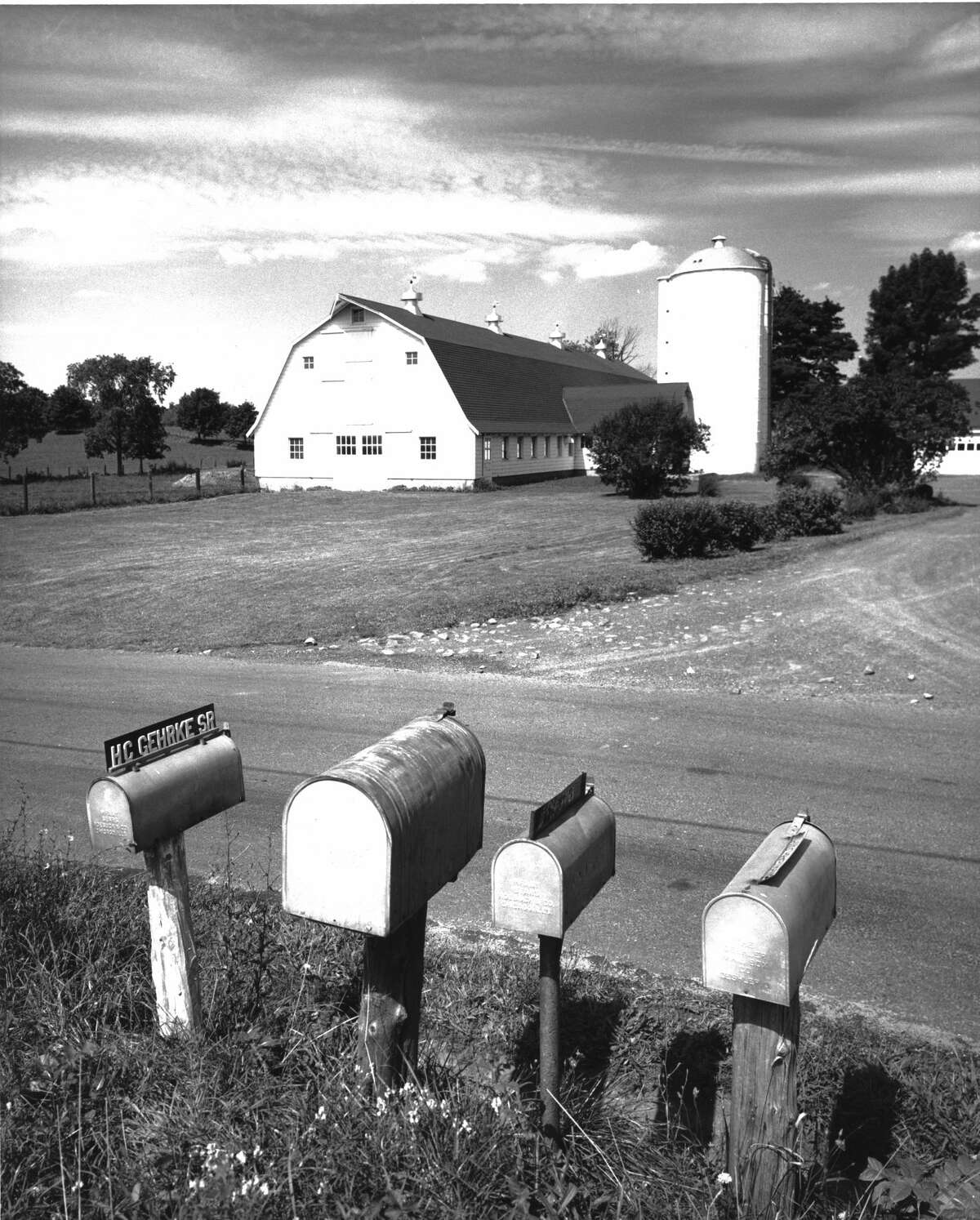 View of mailboxes at the side of the road in front of a dairy farm in Connecticut. (Photo by Camerique/Getty Images)