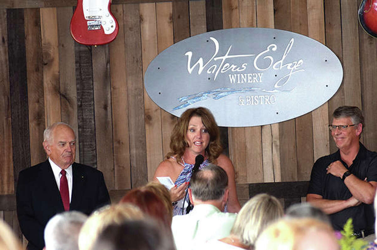 Keith Lape, outgoing Chamber of Commerce chair, (left), Lisa Musch, of the Jacksonville Area Chamber of Commerce, and Jess Spradlin (right) speak during the annual meeting Tuesday evening at Waters Edge Winery and Bistro in Jacksonville.