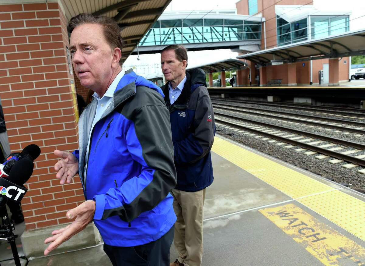 Governor Ned Lamont (left) speaks at a press conference at West Haven Station following heavy rain from Tropical Storm Elsa on July 9, 2021.