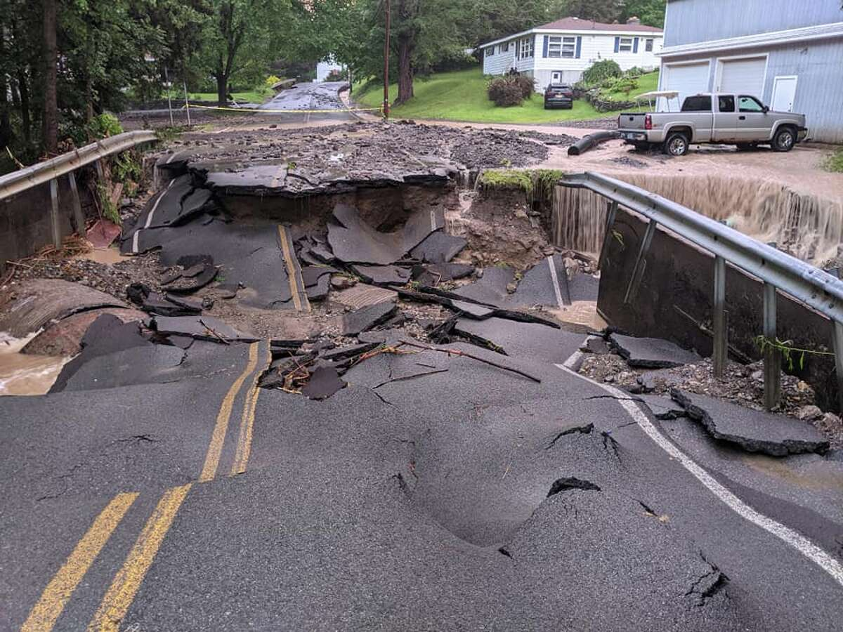 Heavy downpours Wednesday damaged roads in central and southern Rensselaer County, including this portion of Taborton Road in the town of Sand Lake.