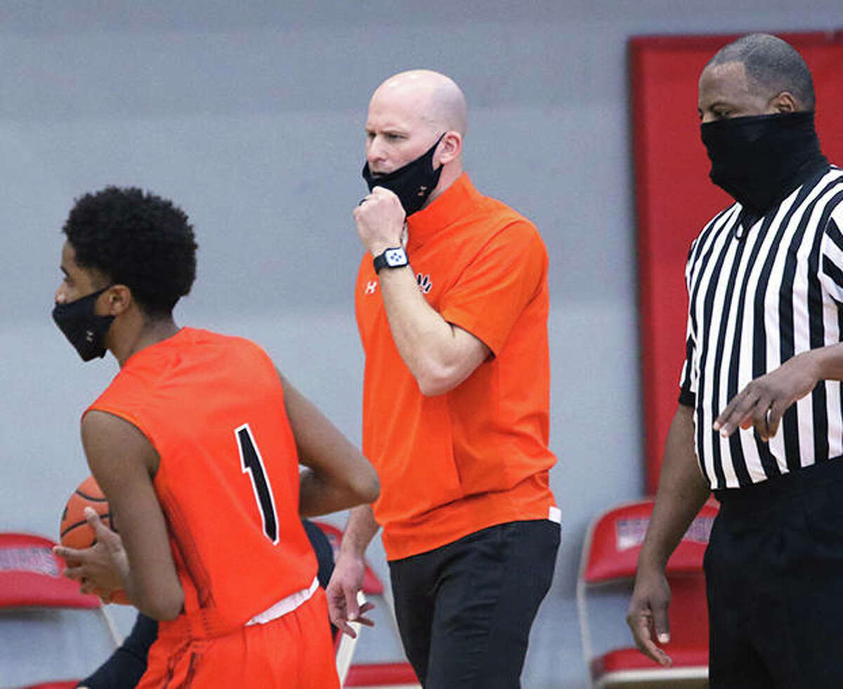 Edwardsville coach Dustin Battas (middle) watches from the sideline in a Tigers win over Alton on Feb. 20 at Alton High in Godfrey. Battas is the 2021 Telegraph Large-Schools Boys Basketball Coach of the Year.