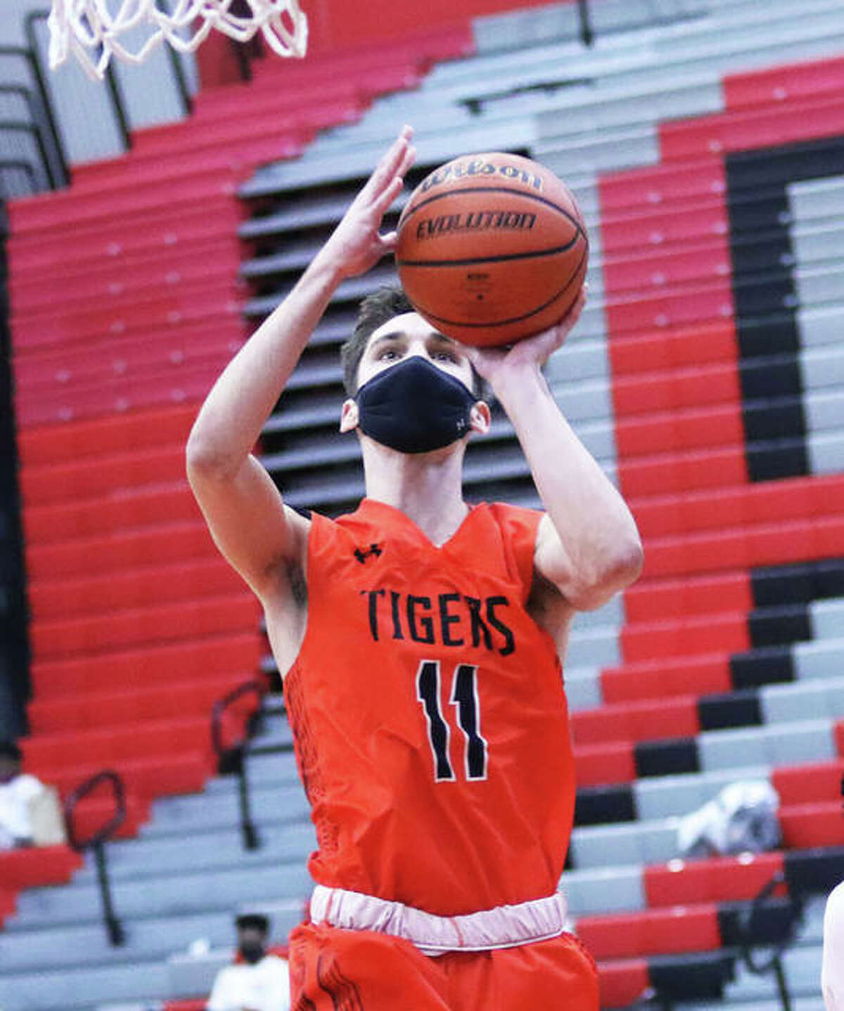 Edwardsville's Brennan Weller scores two of his 30 points in a Feb. 20 win at Alton. Weller led the SWC in scoring at 18.8 points per game and finished his career with 1,216 points.