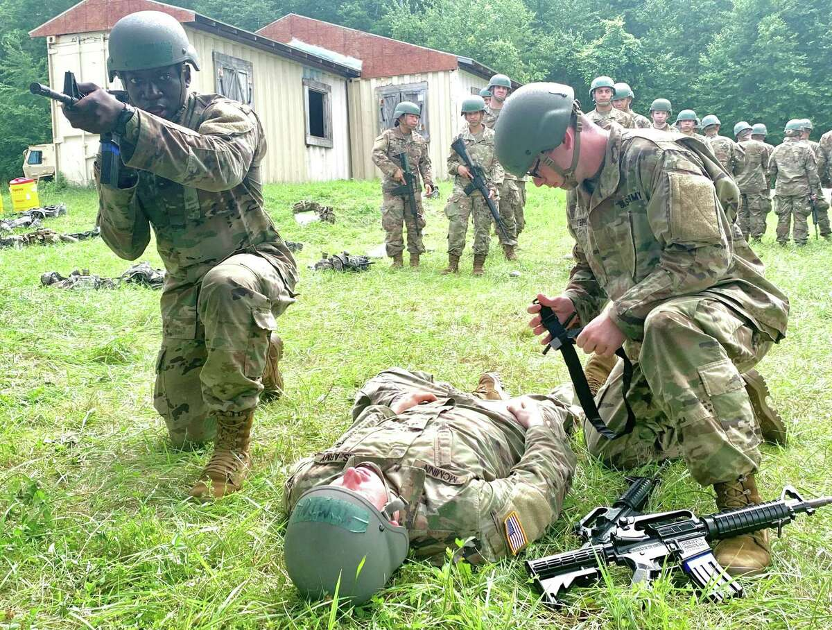 U.S. Army officer candidates train to move a wounded solider under fire at Officer Candidates School at Stones Ranch Military Reservation in East Lyme, Conn.
