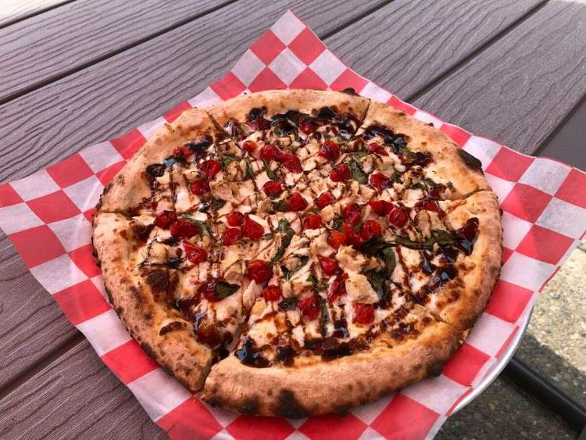Pizza Baker's pollo pizza comes topped with a savory cheese blend, cubed chicken, basil, sweety drop peppers and drizzled with a balsamic glaze.