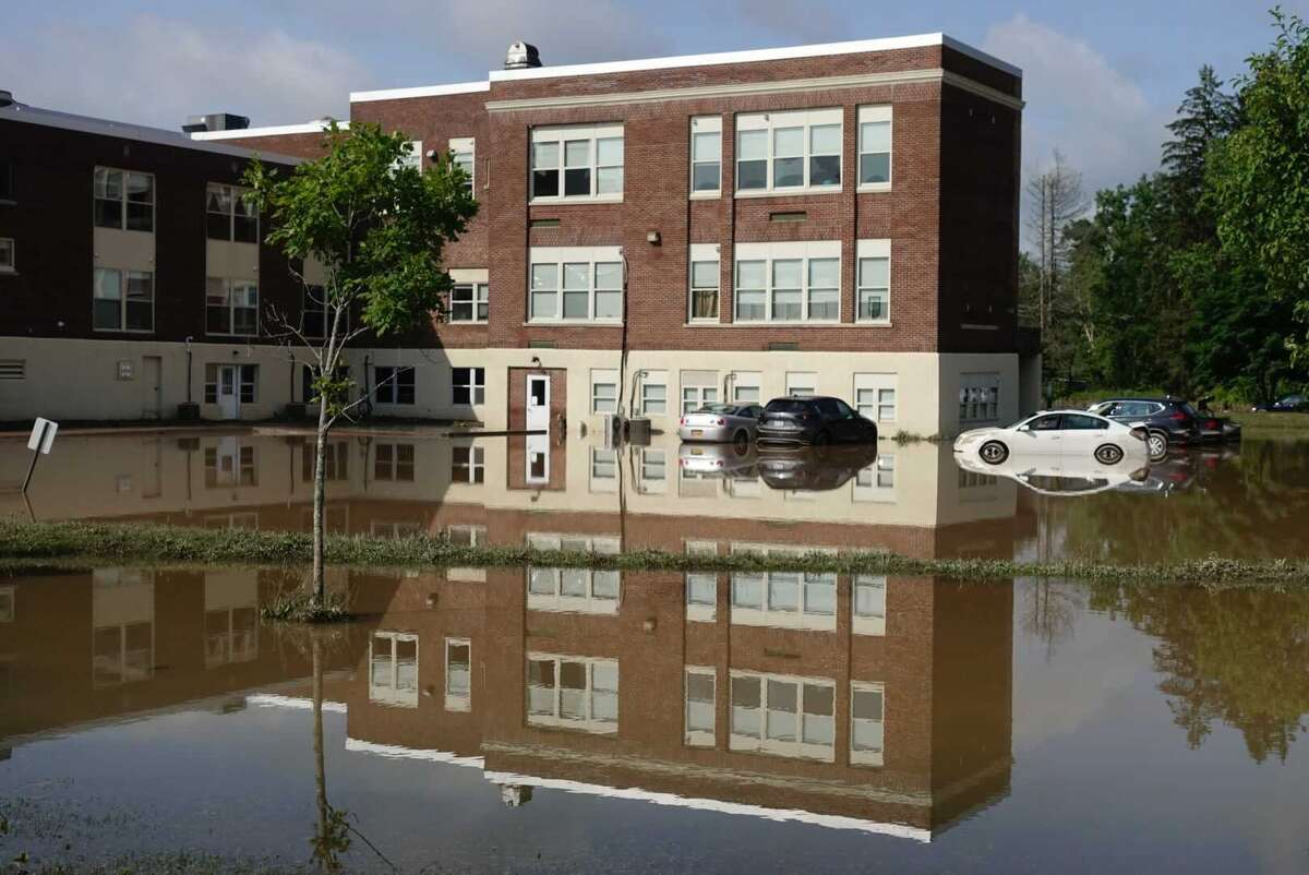 Flood waters surround the Homeroom Lofts in Averill Park on July 15, 2021, a day after torrential rains soaked parts of Rensselaer County. July was one of the region's wettest in history pushing summer rainfall totals into the top 20 for the rainiest summers since records began being kept in 1826.