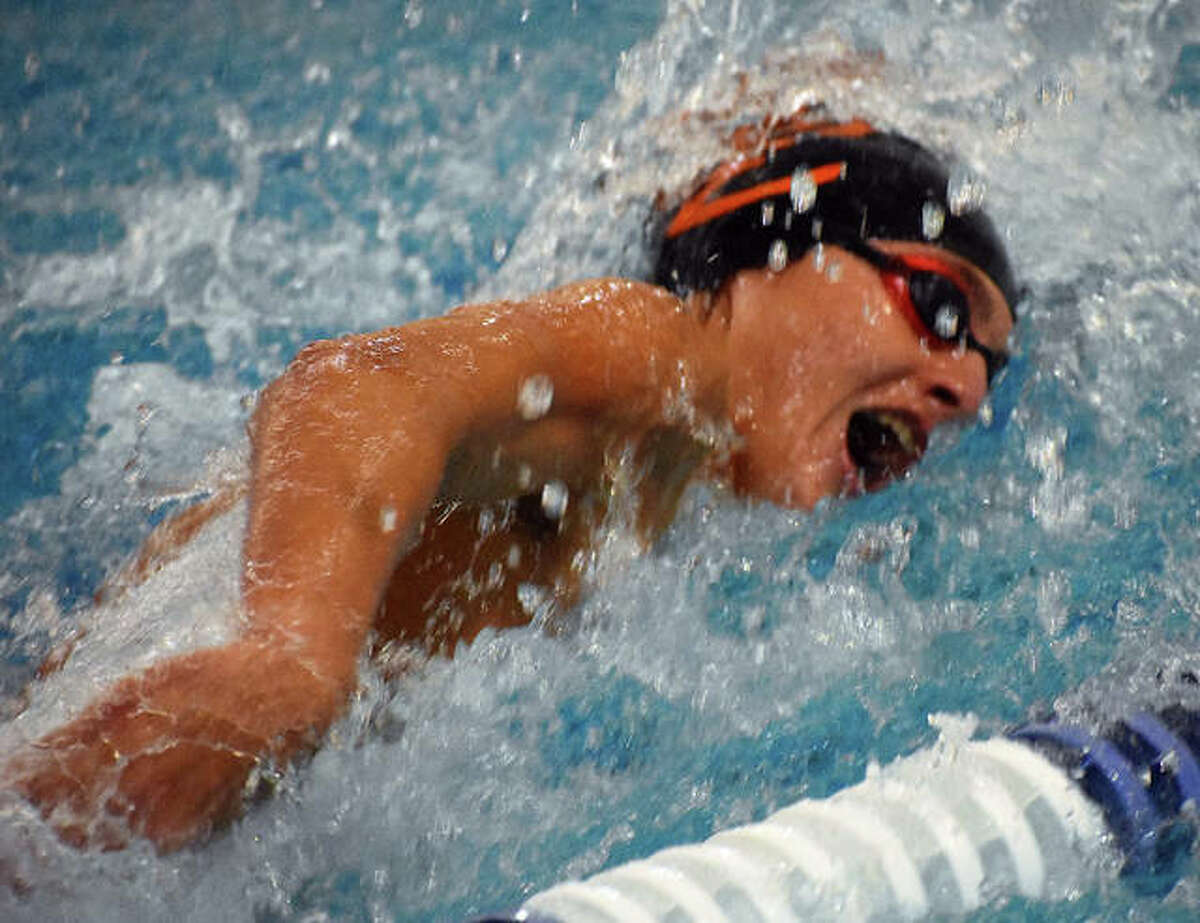 Edwardsville's Evan Grinter competes in the 50-meter freestyle during a dual meet against the O'Fallon Panthers at the Chuck Fruit Aquatic Center.