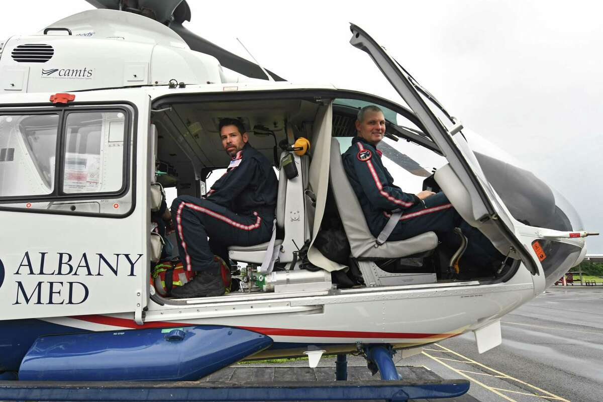 Air Methods (LifeNet) nurse Brian Sicke, left, and pilot Ben Davenport are seen in an air ambulance helicopter at the South Albany Airport on Friday, July 9, 2021 in Selkirk, N.Y. (Lori Van Buren/Times Union)