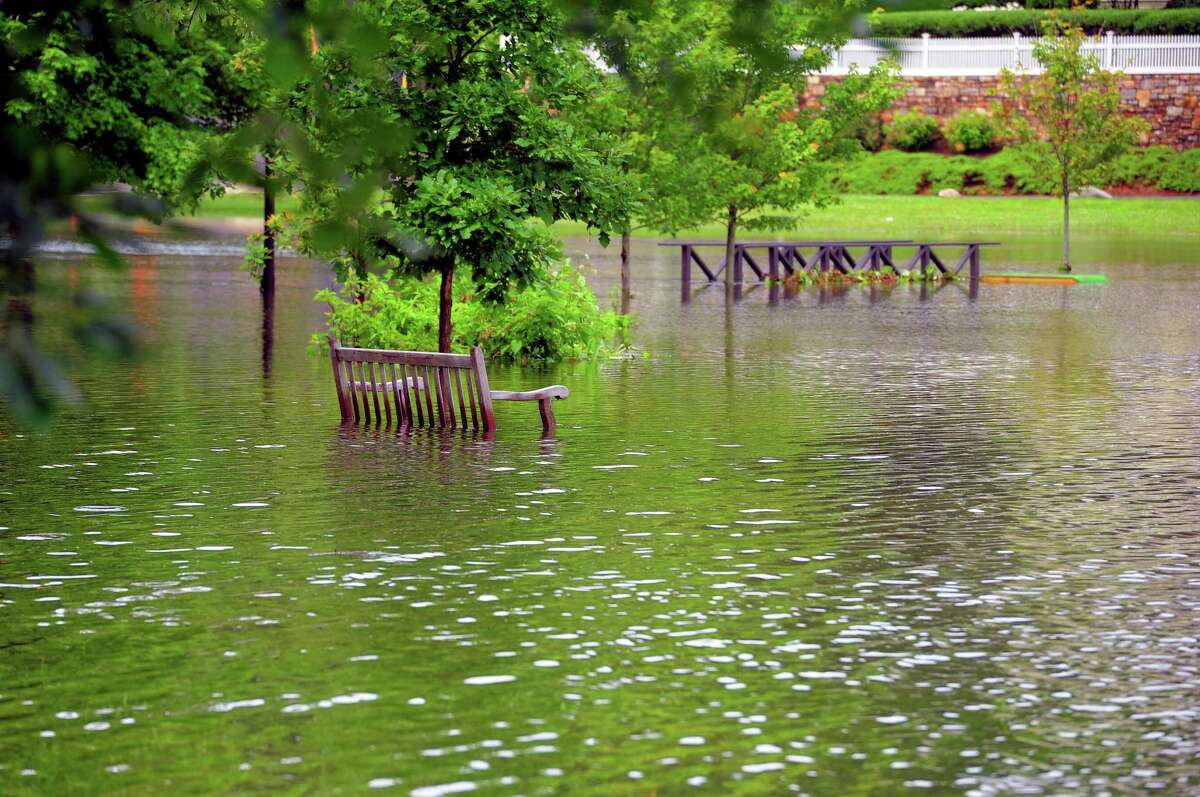 Binney Park in Greenwich is submerged after a tropical storm pounded the region in July 2021. Storms are expected to become more severe as global warming worsens in years to come.