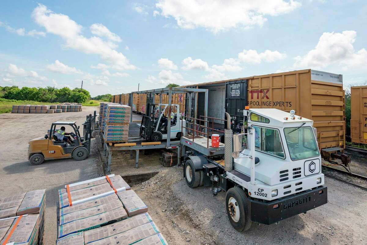 During operations at TLD Ramp Inc. which developed a patented mobile platform which can be pulled up to any train at any railroad spur for unloading any palletized cargo. Friday, July 2, 2021, in Sealy