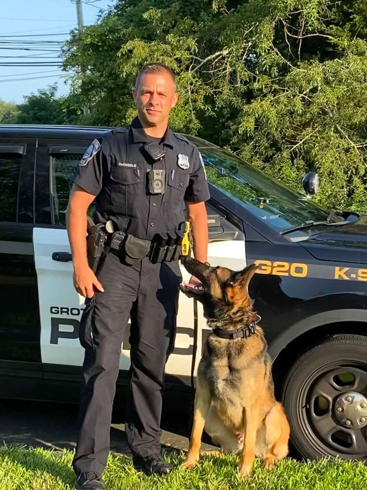 Officer Tyler DeAngelo and police dog Jax recently graduated from a K-9 program. Jax is one of two police dogs to recently join the Groton, Conn., police force.
