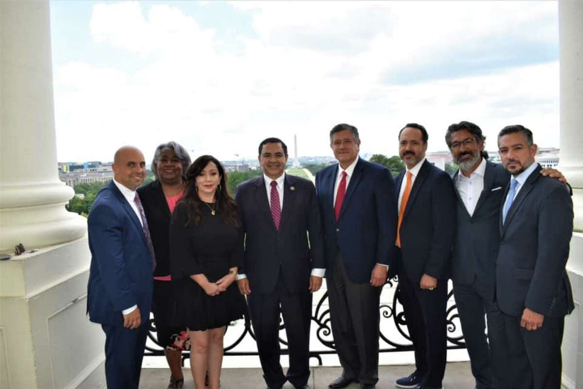 Rep. Henry Cuellar, fourth from left, is joined Wednesday by Texas and Webb County Rep. Richard Raymond, fourth from right, and other state Democrat leaders who fled the state recently to avoid the elections bill.