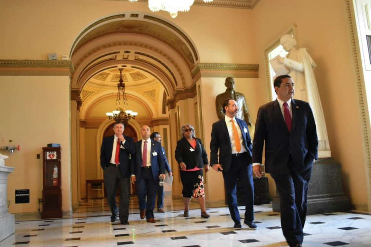 Rep. Henry Cuellar leads Texas Democratic leaders walking inside the U.S. Capitol on Wednesday.