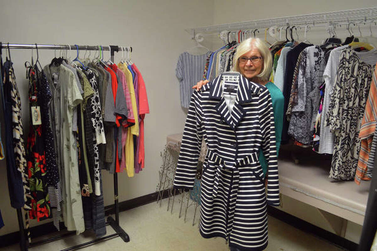 Main Street Community Center volunteer Judy McClew with some of the clothes for sale at the newly remodeled MSCC Release Boutique, which has its grand reopening on Thursday.
