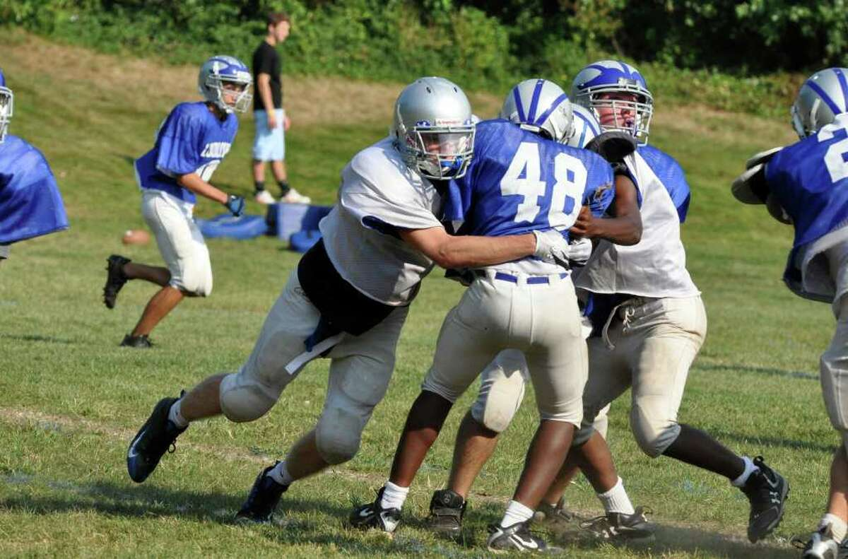 Fairfield Ludlowe football captain Chris Boardman makes a tackle during practice.