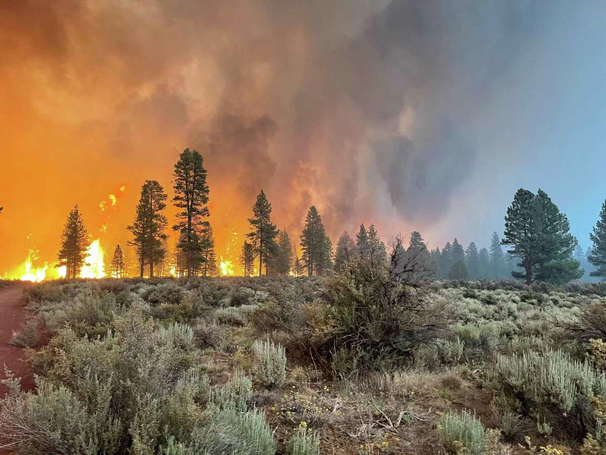 In this handout provided by the USDA Forest Service, the Bootleg Fire burns in Bly, Ore. The Bootleg Fire has has spread over 212,377 acres, making it the largest among the dozens of blazes burning in the western U.S. fueled by record temperatures and drought.