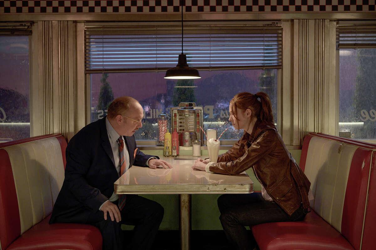 "Paul Giamatti, left, and Karen Gillan in ""Gunpowder Milkshake."""