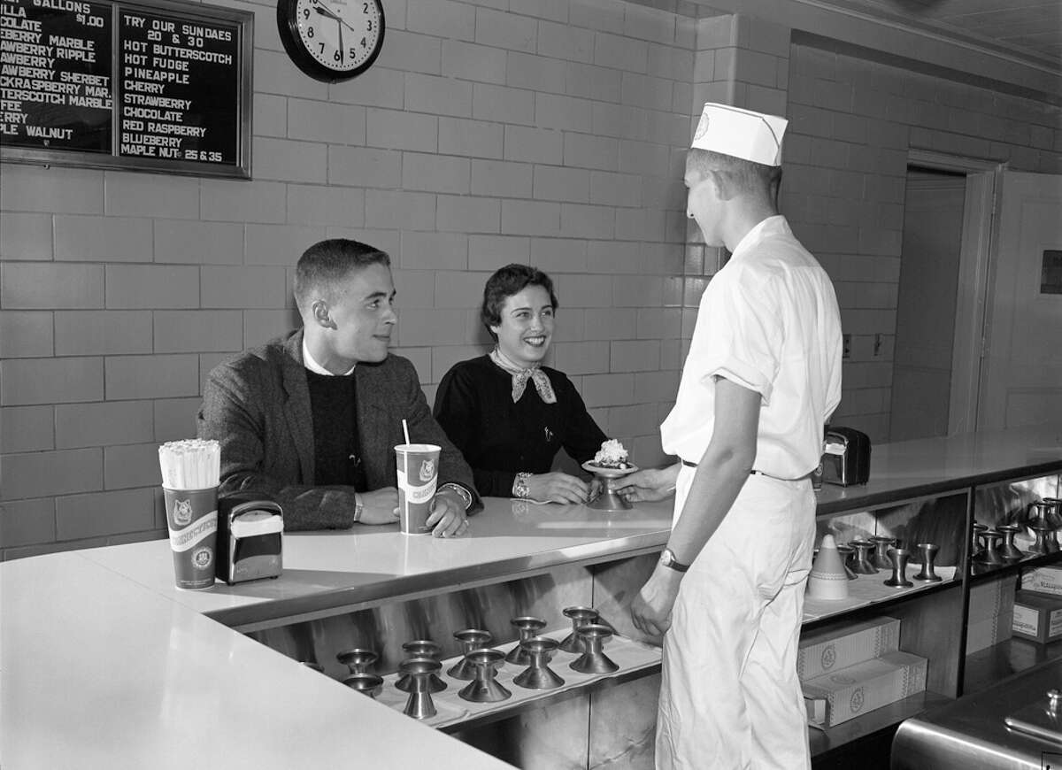 Peter Fraser Pierpont and Diana Martha Klug in the Dairy Soda Bar at UConn with Peter Schoech serving on Oct. 10, 1957.