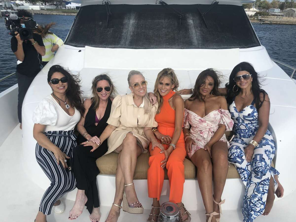 """Westport author Emily Liebert and the cast of """"Real Housewives of New Jersey"""" photographed on Liebert's boat in Norwalk during filming for an episode."""