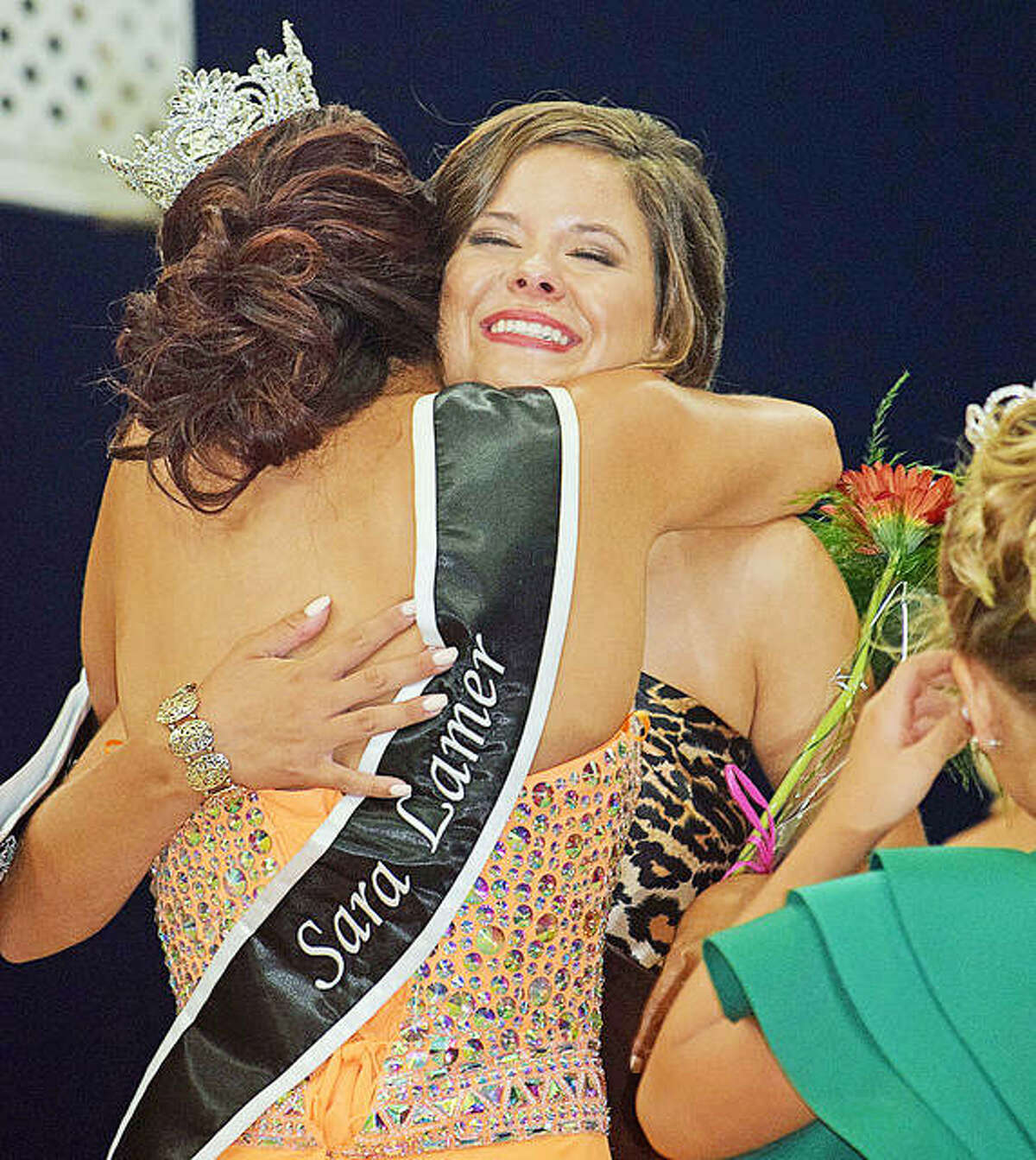 Aubrey McCormick of Jerseyville hugs 2019 Queen Sara Lamer after McCormick was named the 2021 Miss Jersey County Fair Queen on Wednesday.