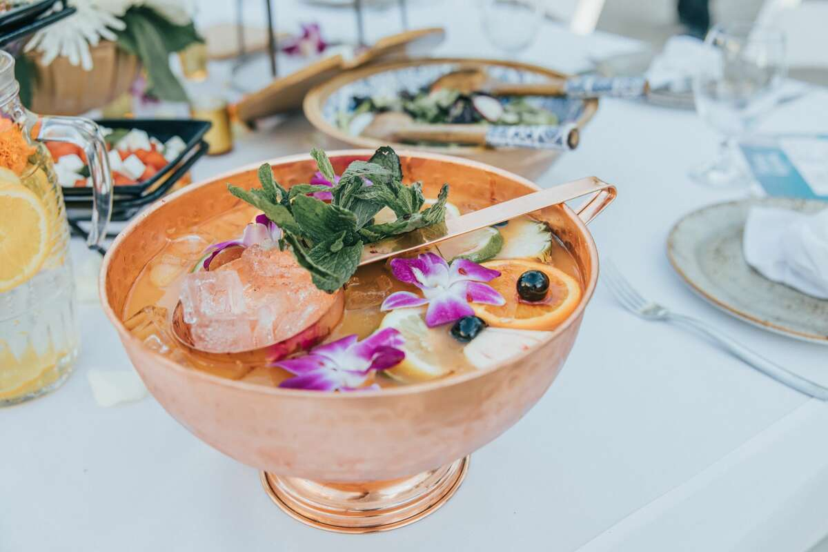"""Foxwoods' new outdoor pop-up dining experience is described as a """"secret garden fantasy come to life."""" Green Gardens features lush blooms and greenery, an indulgent food menu and craft cocktails."""