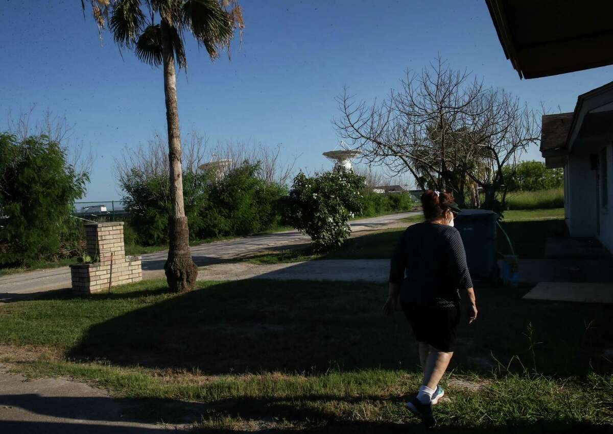 Celia Garcia-Johnson walks back to her home after leaving a second home she owns Tuesday, June 15, 2021, in Boca Chica Village, an unincorporated community near Brownsville. SpaceX has built rocket launch facilities in the area and bought homes in Boca Chica Village to house its workers. Some residents who are left, including Garcia-Johnson, lament the loss of their beach community, and some feel that the company has tried to force out residents.