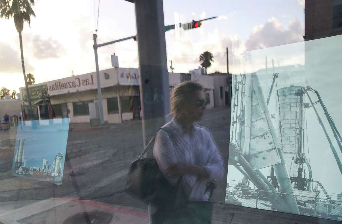 """Diane Milliken Garza talks about downtown Brownsville and the impact of the presence of SpaceX nearby as she stands in front of her gallery Wednesday, June 16, 2021, in Brownsville. The gallery had hosted an exhibit titled """"Boca Chica to Mars,"""" which featured rocket-themed artworks, many by local artists."""